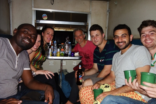 Train stopped in Mlimba time for a few drinks Right to Left Brian, Mina, Flynn, Greg, Imogen, Webster